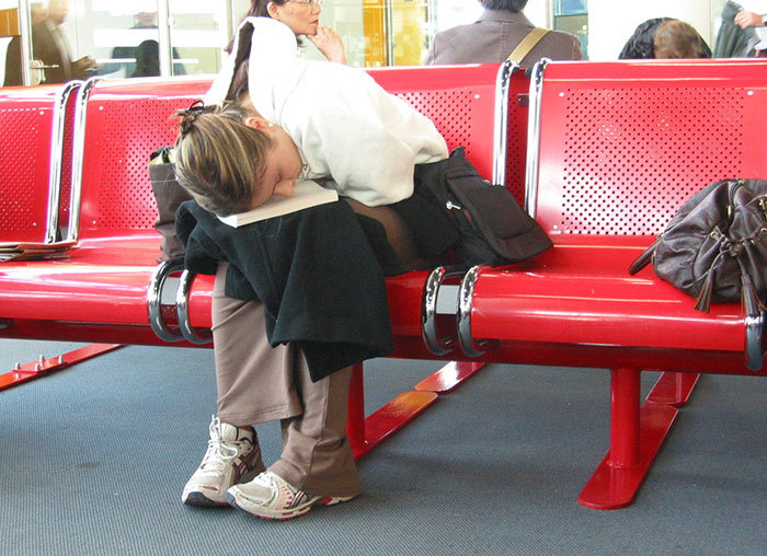 Sleeping in Airports Girl on Bench